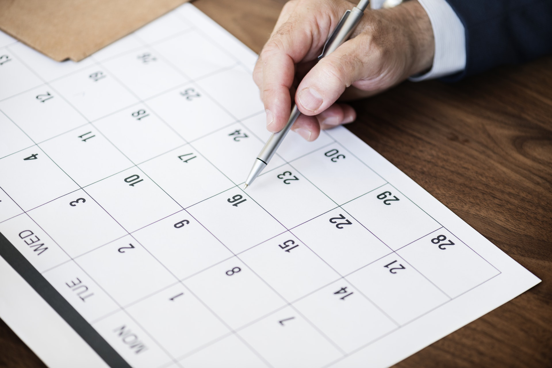 Why are paid holidays beneficial to an employer?